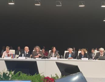 Vice-President Asma El Kasmi surrounded by Honorary President Benedito Braga and Governor Jean Lapègue, during the Roundtable on SDG6 - Building a Resilient Future Through Water, COP25, Madrid, 9 December 2019