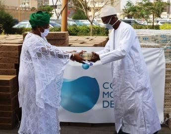Mamadou Dia, World Water Council Governor, hands over soap bars to Soham El Wardini, Mayor of Dakar, Dakar, Senegal, 10 April 2020